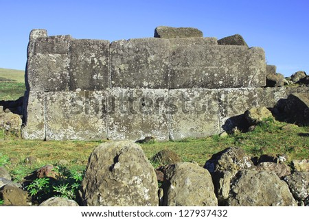 Ahu platform at the Easter Island, Chile. Easter Island has at least 313 ceremonial platforms or ahu � open-air temple sanctuaries erected in honor of the gods and deified ancestors. - stock photo