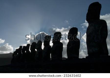 Ahu Tongariki Statues. A row of moai statues on Isla de Pascua in the South Pacific ocean - stock photo