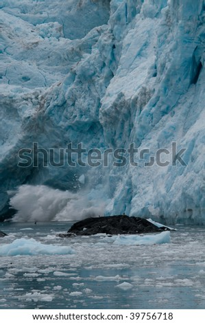 Aialik Glacier calving in Kenai Fjords National Park - stock photo