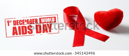 Aids ribbon and heart on white background.  - stock photo