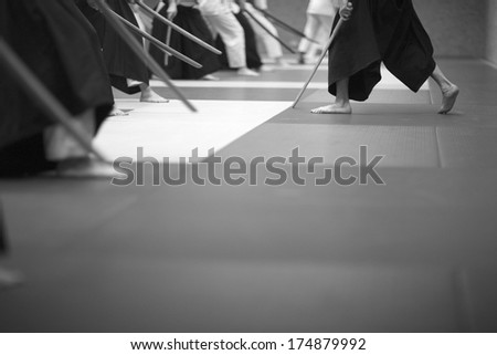 Aikido practice with wooden swords - stock photo