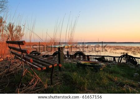 Ailing picnic area on shore of the Baltic sea. - stock photo