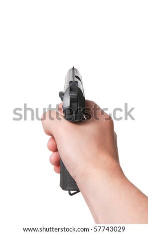 Aiming. Male hand keeps gun - stock photo