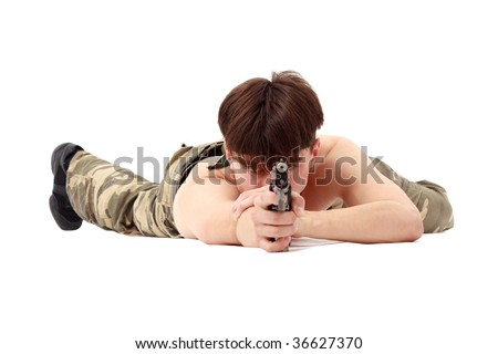 Aiming. Man with gun lying on a white background. - stock photo