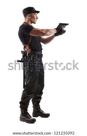 Aiming police officer with gun. Isolated on white.
