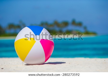 Air ball at white beach with turquoise sea and blue sky - stock photo