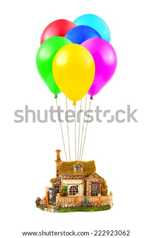Air balloons and house isolated on white background - stock photo
