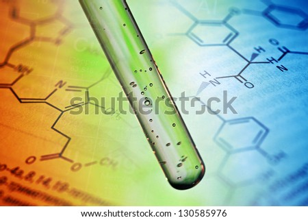 Air bubbles in test tube with liquid material. - stock photo