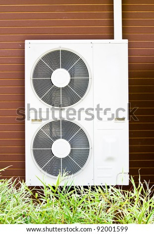 Air compressor located outside cafes. - stock photo