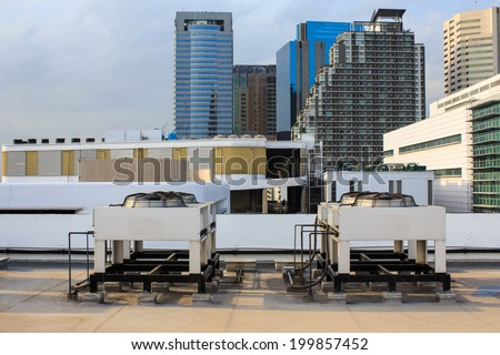 Air compressor on the Building office in city with sky background. - stock photo