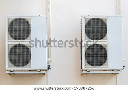 Air compressors unit is outside the office building. - stock photo
