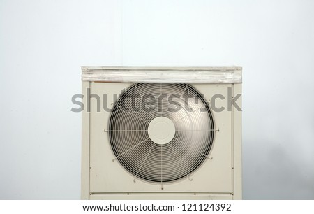 air conditioner behind the wall - stock photo