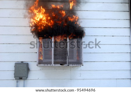 air conditioner on fire - stock photo