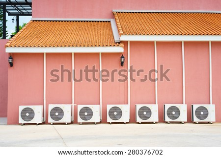 Air conditioner on floor, outdoors. - stock photo
