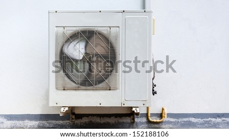 Air conditioner on wall house - stock photo
