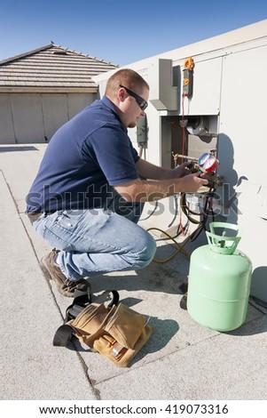 Air Conditioner Repair Man Using Testing Stock Photo