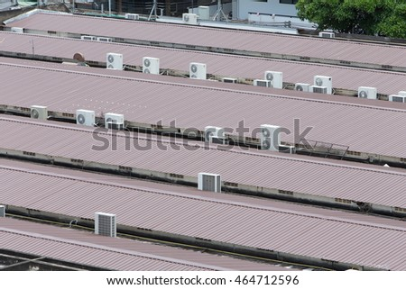 air conditioners condenser units at building rooftop