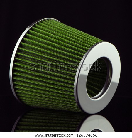 Air cone filter on black background. Vehicle Modification Accessories. - stock photo
