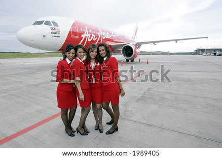 Air crew of Malaysia's low cost carrier AirAsia, 2006. - stock photo