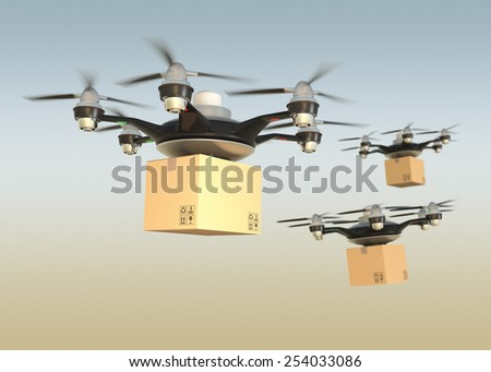 Air drones carrying cardboard in sunset sky - stock photo