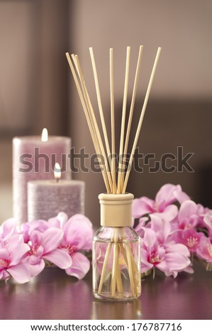 air freshener sticks at home with flowers  - stock photo