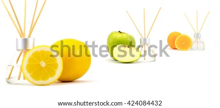 Air freshener sticks with a green apple, lemon and orange isolated on a white background