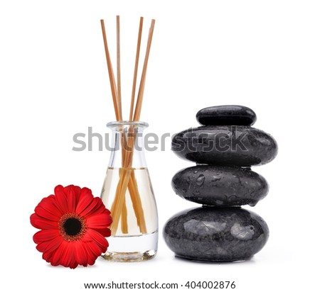 Air freshener with wooden aroma sticks and black spa stones isolated on white background. - stock photo