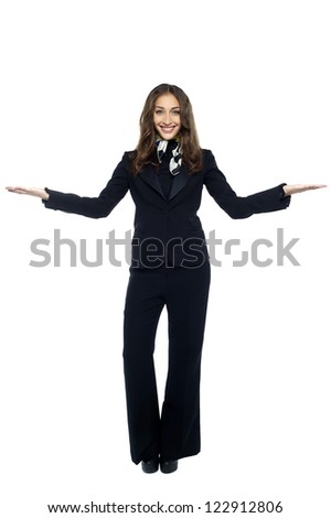 Air hostess welcoming the passengers. Isolated over white. - stock photo