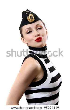 Air kiss.girl in  sea peak-cap.On  white background. - stock photo