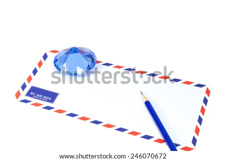 Air mail envelope with blue crystal and blue pencil on white background - stock photo