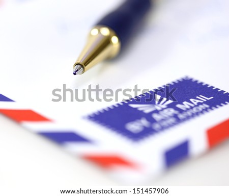 air mail envelope with pen  - stock photo