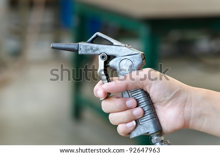 air nozzles gun in hand - stock photo