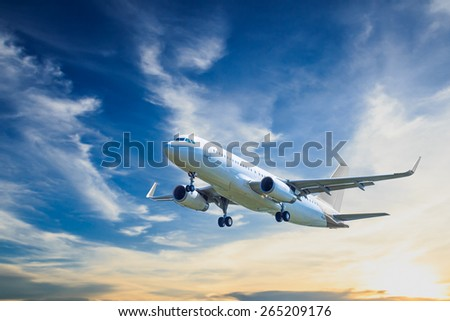 air plane flying on blue sky - stock photo