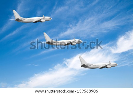 Air plane is flying. With blue and cloudy sky. - stock photo
