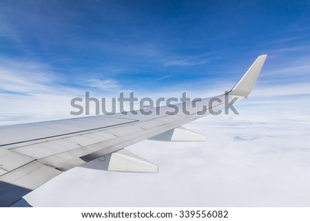 air plane wing with blue sky, wings aircraft with blue sky