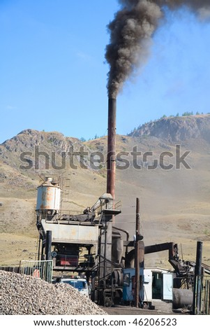 air pollution, asphalt production - stock photo
