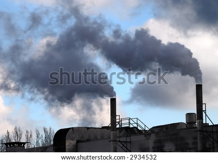 Air pollution by dark smoke coming out of two factory chimneys - stock photo