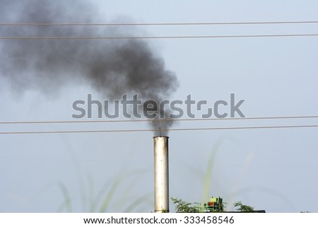 Air pollution by smoke coming out of  factory chimneys. - stock photo