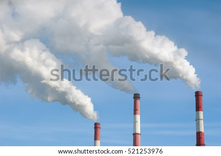 Air pollution by smoke coming out of factory chimneys.