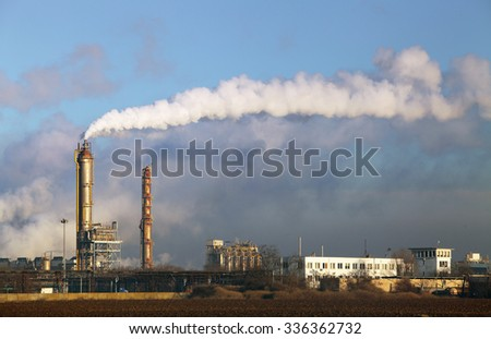 Air pollution coming from factory smoke stacks - stock photo