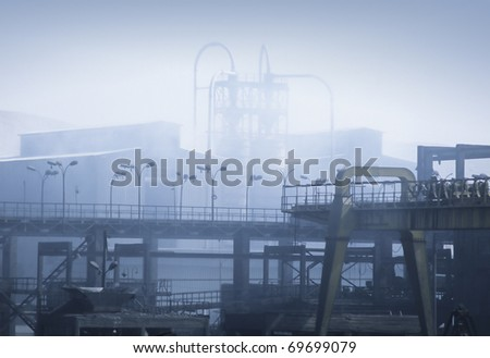 Air pollution from an Iron ore factory - stock photo
