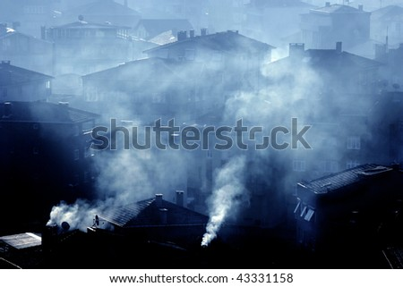 air pollution image of houses and smoke - stock photo