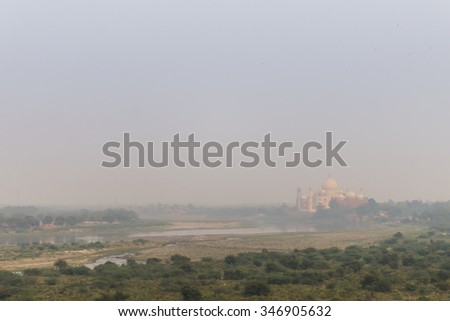 Air Pollution over the Taj Mahal in Uttar Pradesh, India - stock photo