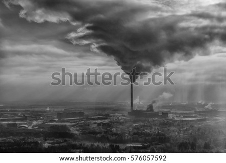 Air pollution smoke from pipes and factory with winter background