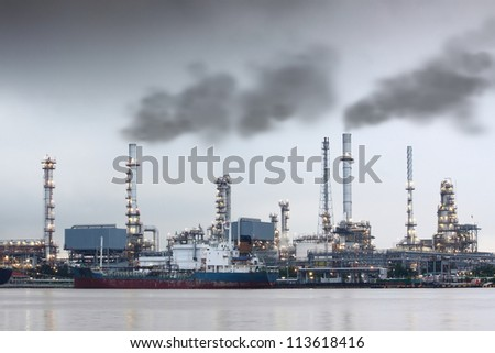 Air Pollution Smoke Over Power Plant Near The River - stock photo