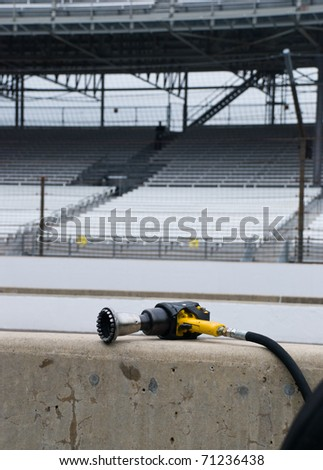 Air Tool on Pit Wall - stock photo