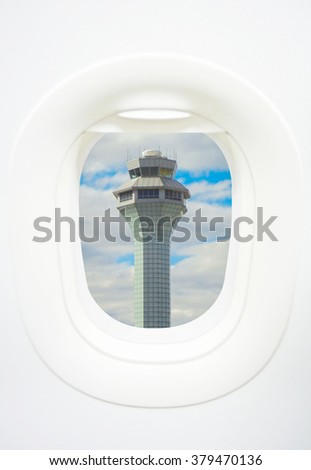 Air Traffic Control tower or ATC viewed from aircraft window - stock photo
