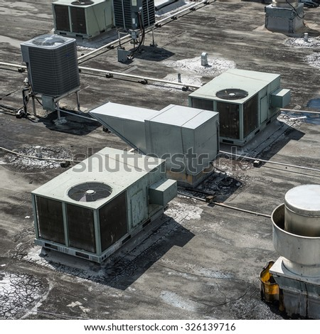 Air ventilation system installed on the roof of the building - stock photo