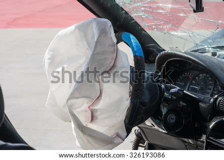 Airbag exploded at a car accident. - stock photo