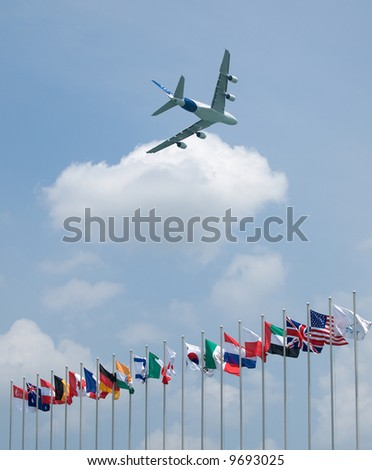 Airbus' A380 demonstration flight at the Singapore Airshow 2008 over the flags of participating countries - stock photo